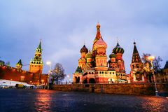 Illuminated Saint Basil Cathedral on Red Square at night with Kremlin wall and Tower royalty free stock images