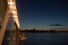 Illuminated ship and cityscape Royalty Free Stock Images