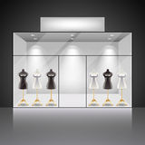 Illuminated shop showcase interior with mannequins Royalty Free Stock Photo