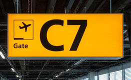 Illuminated sign at airport with gate number Stock Photos