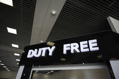 Illuminated sign Duty Free in the airport. Stock Photos
