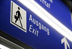 Illuminated sign to the exit Royalty Free Stock Photography