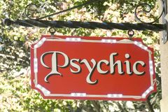 Psychic Sign. An illuminated sign with the word Psychic Stock Photography