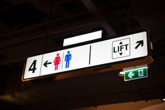 Illuminated signboard Level toilet parking lift in shopping mall.  Stock Image
