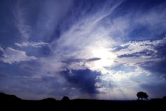 Illuminated Sky. Rural scene with a deep blue, cloudy sky royalty free stock image