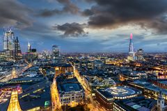 The illuminated skyline of London on evening time. From the City to the Tower Bridge, UK royalty free stock image