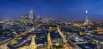 The illuminated skyline of London by night. From the City to the Tower bridge stock photo
