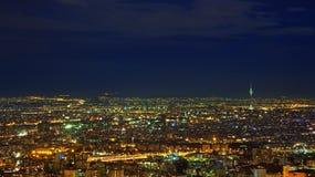 Illuminated Skyline of Tehran Against Dark Blue Sky Stock Photos