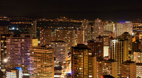 Illuminated skyscrapers of a Benidorm city at night Royalty Free Stock Photos