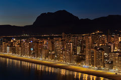 Illuminated skyscrapers of a Benidorm city at night. Spain Stock Images