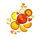 Illuminated slices of citrus fruits on white background. Top view stock image