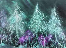 Illuminated snow covered Christmas trees with an night sky. Royalty Free Stock Images