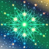 Illuminated snowflake on blue, green and yellow gradient background with sparkles. Abstract illuminated snowflake on blue, green and yellow gradient background Stock Photo
