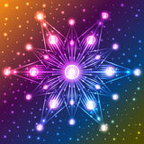 Illuminated snowflake on orange, blue, violet and yellow gradient background with sparkles Royalty Free Stock Photo
