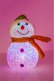 Illuminated snowman on pink background Royalty Free Stock Photos