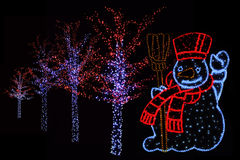 Illuminated Snowman and trees Stock Photography