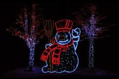 Illuminated Snowman and trees Royalty Free Stock Photo