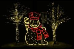 Illuminated Snowman and trees Royalty Free Stock Photography