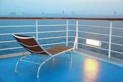 Illuminated solitary deck-chair on ship Royalty Free Stock Image