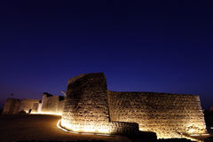 The illuminated southern wall of Bahrain fort Royalty Free Stock Photos