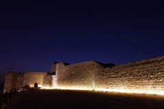 The illuminated southern wall of Bahrain fort Stock Photo