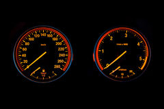 Illuminated speedometer and tachometer Royalty Free Stock Photo