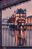 Hamburg`s Speicherstadt while evening with illuminated balcony royalty free stock image