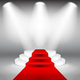 Illuminated stage podium with red carpet vector. Illuminated stage podium with red carpet photo realistic vector background Stock Image