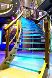 Illuminated staircase. Colourful illuminated staircase in business building stock photos