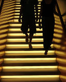Illuminated Stairs. Two people walking down an illuminated staircase in a southern German city Stock Photos