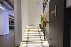Illuminated stairs in empty corridor Stock Photo