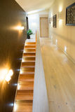 Illuminated stairs in luxury residence Stock Photo