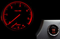 Illuminated Start Stop engine button. In a sport car Stock Photos