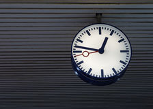 Illuminated station clock royalty free stock images