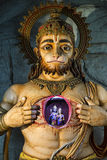 Illuminated statue of Hanuman showing Rama and Sita Royalty Free Stock Photography