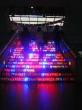 Illuminated steps. Three women go up illuminated  advertisement steps Stock Photo