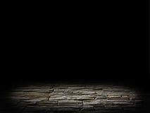 Illuminated stone floor on a black background Stock Photos