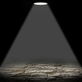 Illuminated stone floor on a black background Stock Photography