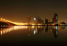 Illuminated street lights and Juffair buildings with reflection, Bahrain Stock Image
