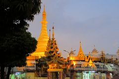 Illuminated Sule pagoda in Yangon, Myanmar Stock Photo