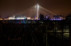 Illuminated Suspended bridge over railway urban modern landmark city night scene Stock Images