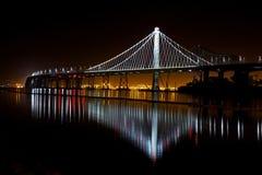 Illuminated Suspension Bridge Against Sky at Night Stock Image