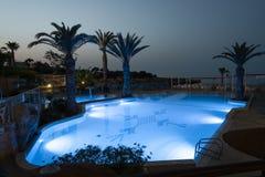 Illuminated swimmig pool. Of Malama Beach Holiday Village, Paralimni, Cyprus Stock Photography