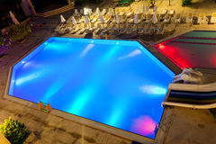 Illuminated swimming pool at night. On tropical resort Stock Images
