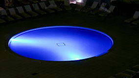 Illuminated swimming pool at night Stock Image