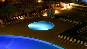 Illuminated swimming pool at night Royalty Free Stock Photo