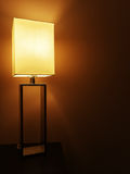 Illuminated table lamp in a dark room Royalty Free Stock Images