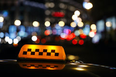 Illuminated taxi cab sign on a city street Royalty Free Stock Photography