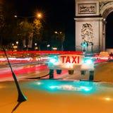 Illuminated taxi sign of a Parisian taxi stock photo