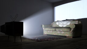 Illuminated Television And Lonely Old Couch Royalty Free Stock Image